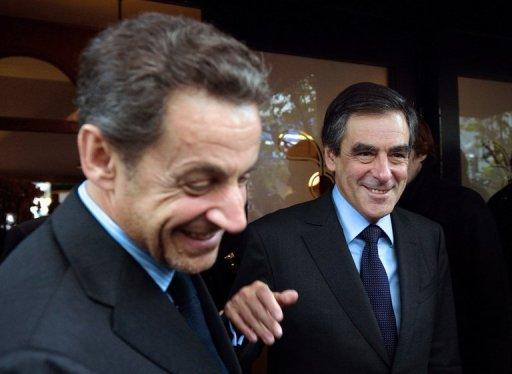 Former French president Nicolas Sarkozy (L) and ex-prime minister Francois Fillon leave a restaurant in October 2012