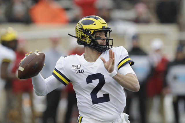 Michigan quarterback Shea Patterson (2) throws during the first half of an NCAA college football game against Indiana, Saturday, Nov. 23, 2019, in Bloomington, Ind. (AP Photo/Darron Cummings)