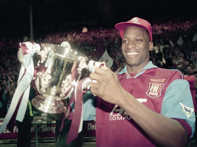 Aston Villa defender Ugo Ehiogu holding the trophy after their victory over Leeds United in the Coca Cola League Cup Final at Wembley stadium. Aston Villa won 3-0 (Getty Images)