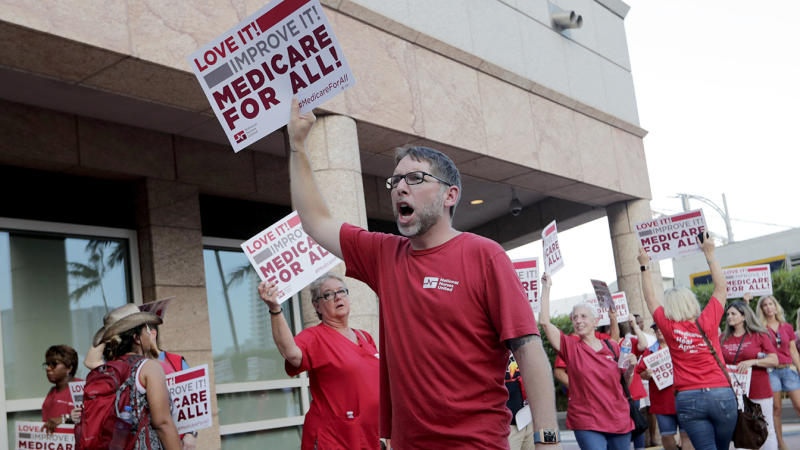 Supporters of with National Nurses United demonstrate in Miami. (Lynne Sladky/AP)