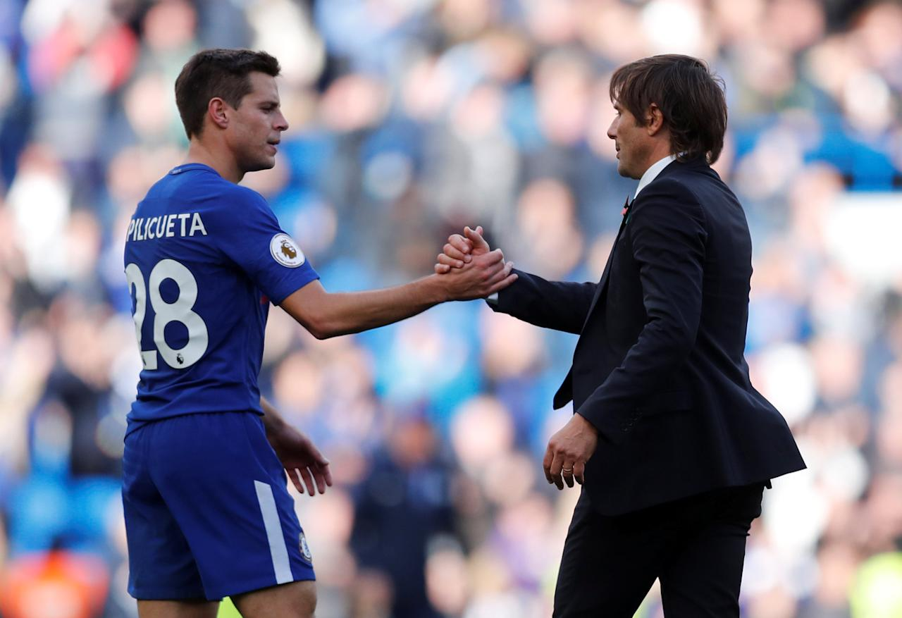 """Soccer Football - Premier League - Chelsea vs Watford - Stamford Bridge, London, Britain - October 21, 2017   Chelsea manager Antonio Conte shakes hands with Cesar Azpilicueta after the match    REUTERS/Eddie Keogh    EDITORIAL USE ONLY. No use with unauthorized audio, video, data, fixture lists, club/league logos or """"live"""" services. Online in-match use limited to 75 images, no video emulation. No use in betting, games or single club/league/player publications. Please contact your account representative for further details."""