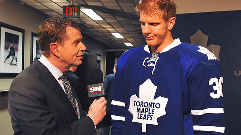 Paul Hendrick interviews former Maple Leafs defenceman Carl Gunnarsson. (Getty)