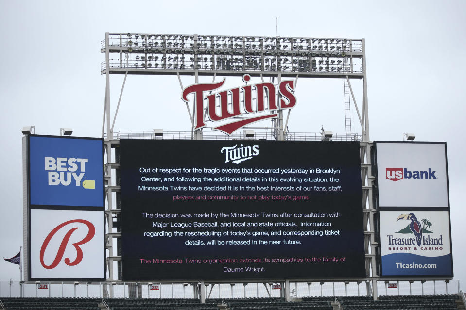 The scoreboard at Target Field explains the postponement of the baseball game between the Minnesota Twins and Boston Red Sox on Monday, April 12, 2021, in Minneapolis. The Minnesota Twins have postponed their game against the Boston Red Sox because of safety concerns following the fatal police shooting of a Black man in a nearby suburb. (AP Photo/Stacy Bengs)