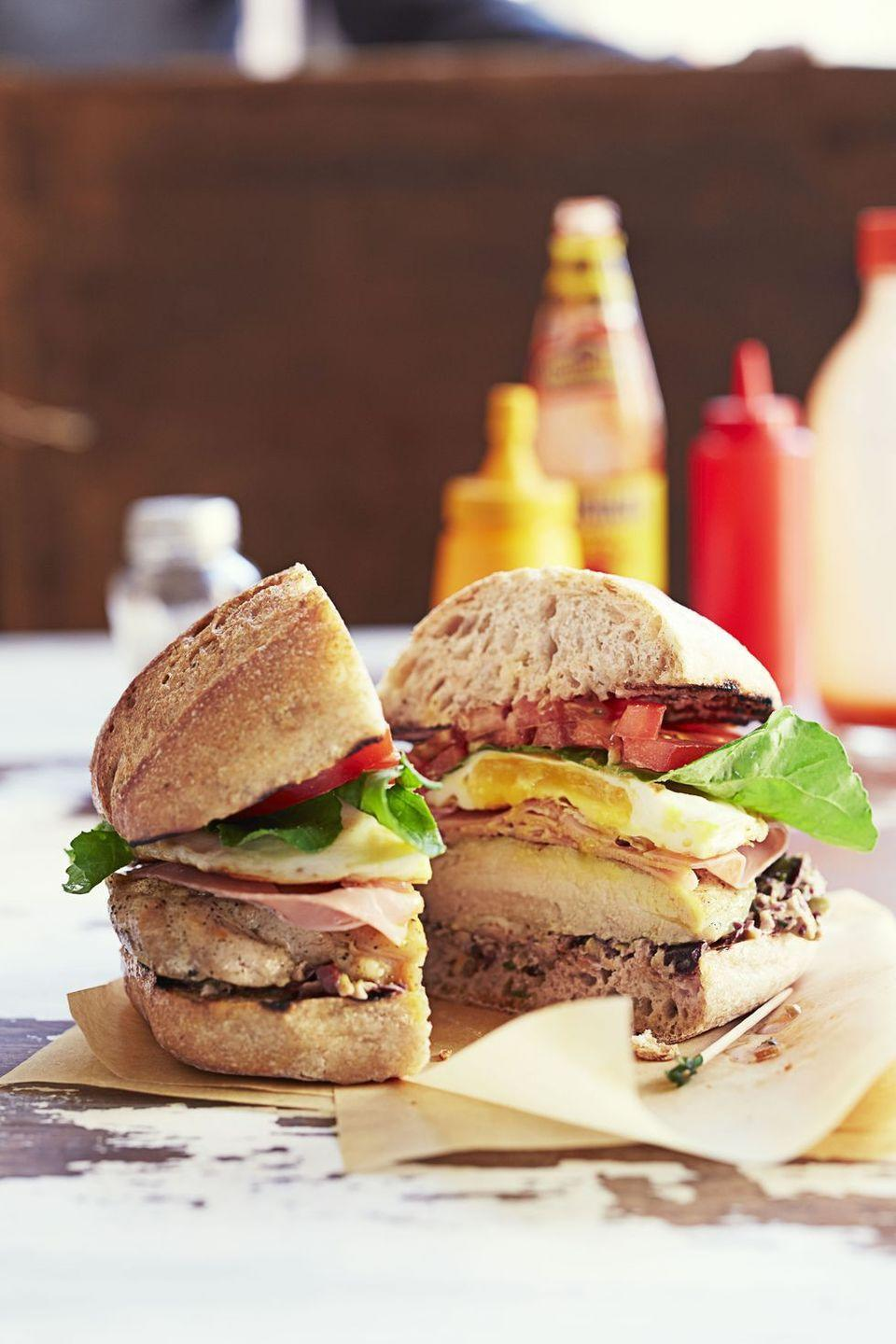 """<p>No brunch menu is complete without a sandwich or two, and this chicken and egg option is a real standout. </p><p><em><em><a href=""""https://www.goodhousekeeping.com/food-recipes/a16992/chicken-chivito-sandwich-recipe-ghk0315/"""" rel=""""nofollow noopener"""" target=""""_blank"""" data-ylk=""""slk:Get the recipe for Chicken Chivito Sandwich »"""" class=""""link rapid-noclick-resp"""">Get the recipe for Chicken Chivito Sandwich »</a></em></em></p>"""