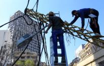 Workers fix damaged cables following Tuesday's blast in Beirut's port area