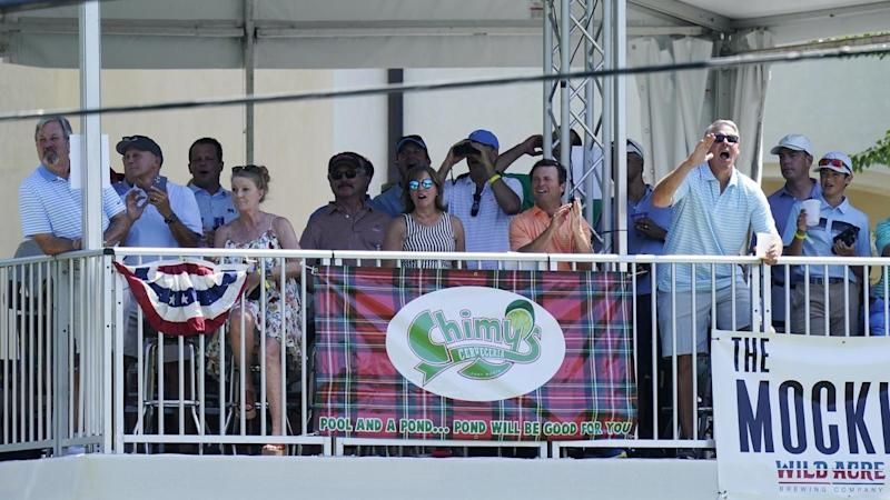 Golf fans watch the PGA Tour event from a viewing stand outside Colonial Country Club in Texas