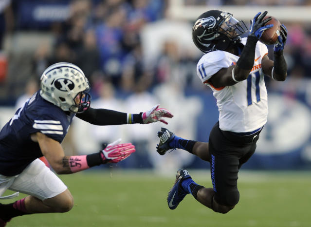 Boise State wide receiver Shane Williams-Rhodes (11) makes a diving grab past linebacker Spencer Hadley, left, in the first half of an NCAA college football game on Friday, Oct. 25, 2013, in Provo, Utah. (AP Photo/Deseret News, Matt Gade)