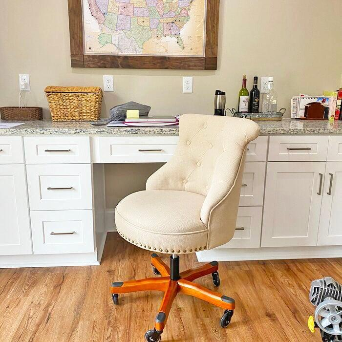 """<h2>Three Posts Eckard Task Chair</h2><br>With over 7,000 5-star reviews, this Wayfair favorite garners its sky-high praise from its well-cushioned and supportive seat, elegant linen upholstery, and smooth wooden base. <br><br><strong>4.7 out of 5 stars and 9,837 reviews</strong><br>""""This chair surpassed all expectations. Easy to assemble, really comfortable, adjustable height, solid wood, sturdy, nice fabric, perfect swivel mobility, turns on a dime quietly. I get compliments every time someone walks into my office. Then they sit down and marvel. I am not making this up. Great value. Here is what else I like I can turn the chair to stand without pushing out, meaning I will not roll over the tail of a sleeping dog!"""" <em>– Wayfair Reviewer</em><br><br><em>Shop <strong><a href=""""https://www.wayfair.com/furniture/pdp/three-posts-eckard-task-chair-w003183375.html"""" rel=""""nofollow noopener"""" target=""""_blank"""" data-ylk=""""slk:Wayfair"""" class=""""link rapid-noclick-resp"""">Wayfair</a></strong></em><br><br><strong>Three Posts</strong> Eckard Task Chair, $, available at <a href=""""https://go.skimresources.com/?id=30283X879131&url=https%3A%2F%2Fwww.wayfair.com%2Ffurniture%2Fpdp%2Fthree-posts-eckard-task-chair-w003183375.html"""" rel=""""nofollow noopener"""" target=""""_blank"""" data-ylk=""""slk:Wayfair"""" class=""""link rapid-noclick-resp"""">Wayfair</a>"""