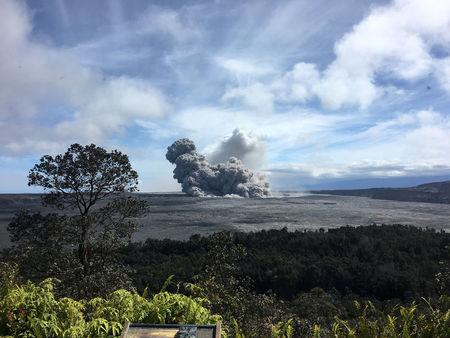 A rising ash plume from Halema'uma'u, a crater at the summit of Kilauea, is seen from the caldera rim near Volcano House in Hawaii, U.S. May 24, 2018.   Picture taken May 24, 2018.    USGS/Handout via REUTERS