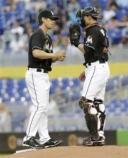 Miami Marlins starting pitcher Kevin Slowey, left, talks with catcher Rob Brantly, right, in the first inning during a baseball game against the Arizona Diamondbacks in Miami, Friday, May 17, 2013. The Diamondbacks scored three runs in the inning. (AP Photo/Lynne Sladky)