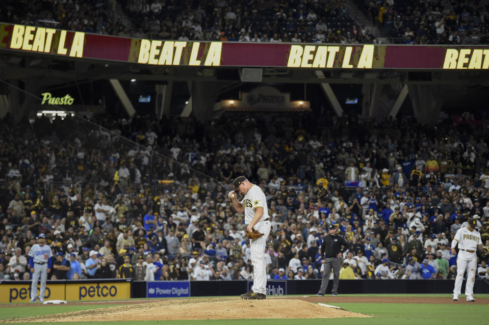 San Diego Padres relief pitcher Mark Melancon (33) stands on the mound between pitches during the ninth inning of a baseball game against the Los Angeles Dodgers Tuesday, June 22, 2021, in San Diego. The Padres won 3-2. (AP Photo/Denis Poroy)