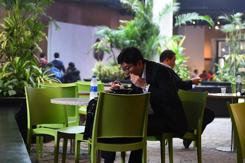 Delhi's eco-eateries, offering cleaner air as well as modern menus to the well heeled are beyond reach for the poor, who have little means of escaping the deadly smog which coats the city for much of the year (AFP Photo/Sajjad HUSSAIN)