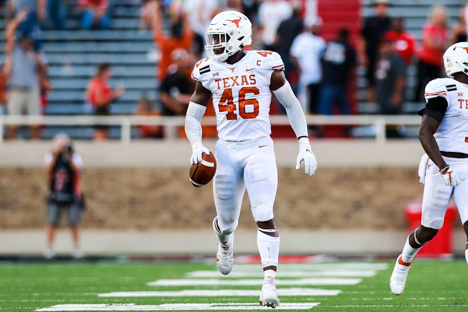 Texas' Joseph Ossai has benefitted from a position switch this season. (Photo by John E. Moore III/Getty Images)