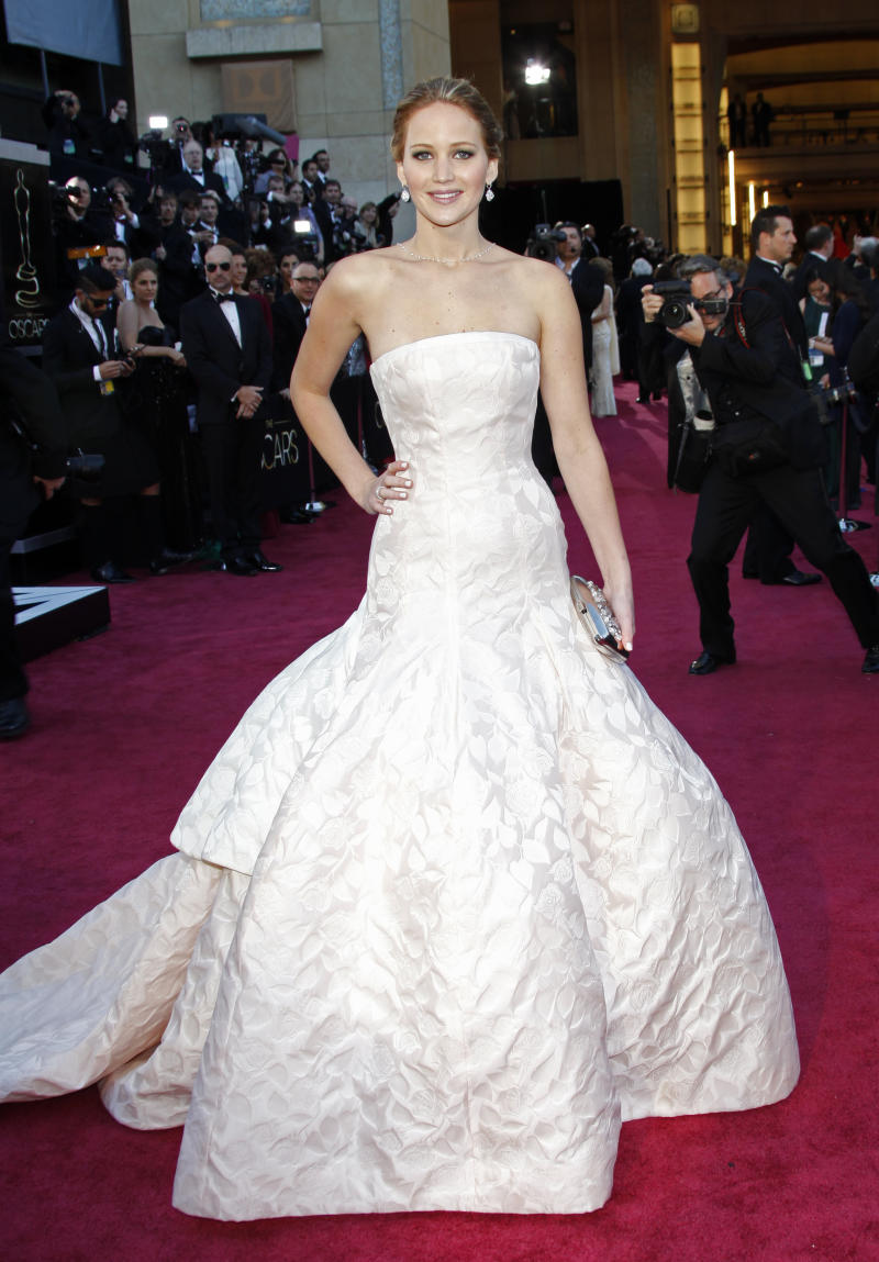 Actress Jennifer Lawrence arrives at the Oscars at the Dolby Theatre on Sunday Feb. 24, 2013, in Los Angeles. (Photo by Carlo Allegri/Invision/AP)