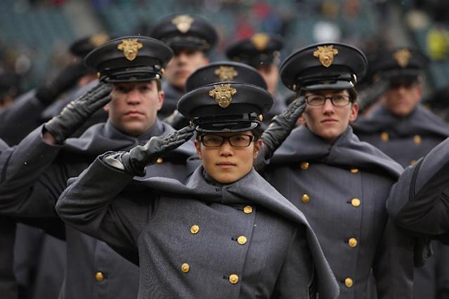 Army cadets salute during the walk-on formation before the start of the Army-Navy NCAA college football game at Lincoln Financial Field Saturday, Dec. 14, 2013, in Philadelphia. (AP Photo/Jacqueline Larma)
