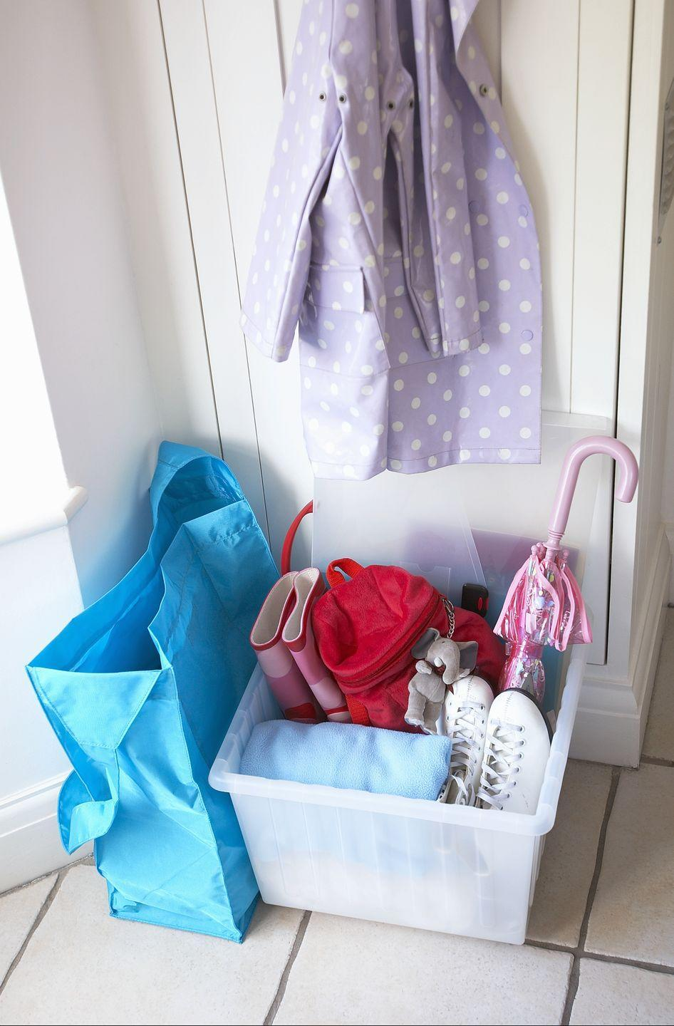 """<p>It seems counterintuitive to your battle against clutter to <a href=""""https://www.goodhousekeeping.com/home/organizing/tips/a32505/organizing-on-autopilot/"""" rel=""""nofollow noopener"""" target=""""_blank"""" data-ylk=""""slk:create a place where you leave piles of stuff"""" class=""""link rapid-noclick-resp"""">create a place where you leave piles of stuff</a>. Designating a spot for everyday items is the stopgap that prevents your entire home from filling with unnecessary clutter. </p>"""