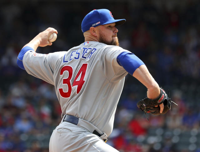 Chicago Cubs starting pitcher Jon Lester (34) throws in the first inning of a baseball game against the Texas Rangers Thursday, March 28, 2019 in Arlington, Texas. (AP Photo/ Richard W. Rodriguez)
