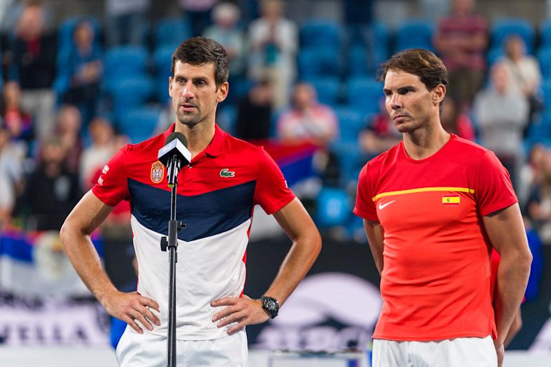 Novak Djokovic talks while Rafael Nadal looks on during the trophy presentation ceremony during day 10 of the ATP Cup at Ken Rosewall Arena on January 12, 2020 in Sydney, Australia.