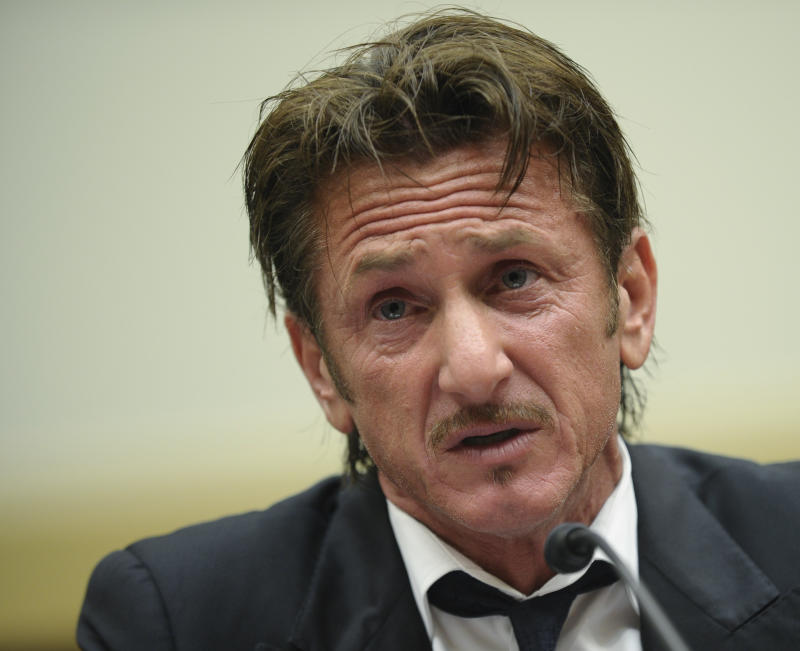 """Academy Award-winning actor Sean Penn testifies on Capitol Hill in Washington, Monday, May 20, 2013, before the House subcommittee on Africa, Global Health, Global Human Rights, and International Organizations hearing on Advocating for American Jacob Ostreichers Freedom after two years in Bolivian detention. Ostreicher was arrested in June 2011 by Bolivian police after it was alleged that he did business with """"people wanted in their countries because of links with drug trafficking and money laundering.""""  (AP Photo/Susan Walsh)"""