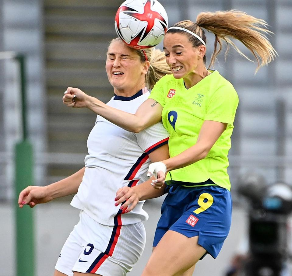 USA's Lindsey Horan battles for the ball with Sweden's Kosovare Asllani.