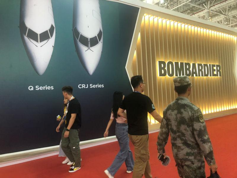 A Bombardier booth promotes the Q400 turboprop plane at Airshow China in Zhuhai