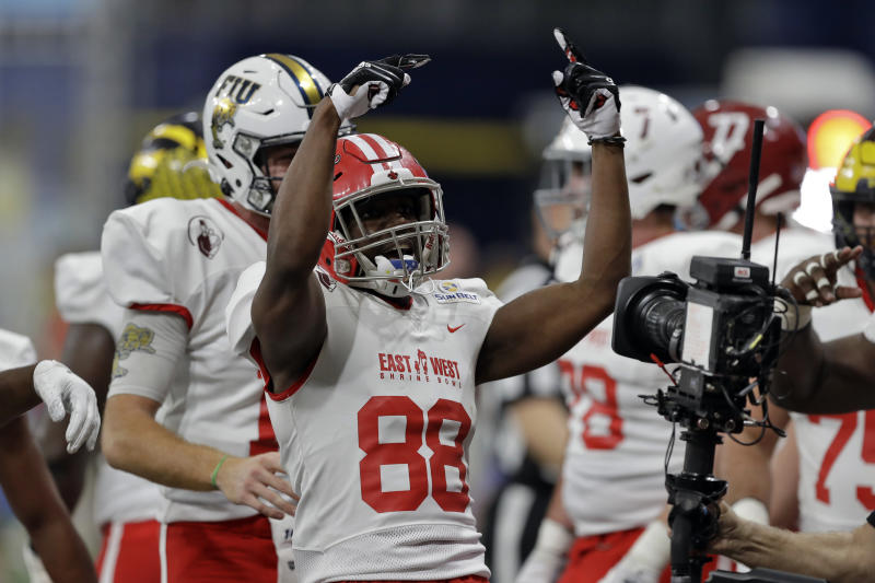 East wide receiver Ja'Marcus Bradley, of Louisiana, (88) celebrates his touchdown against the West during the first half of the East West Shrine football game Saturday, Jan. 18, 2020, in St. Petersburg, Fla. (AP Photo/Chris O'Meara)
