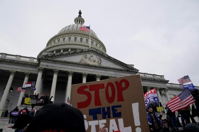 Supporters of US president Donald Trump protest outside the US Capitol on January 6, 2021