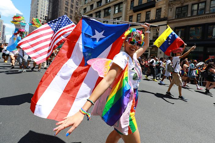 Marchers wave rainbow flags during the NYC Pride Parade in New York, Sunday, June 30, 2019. (Gordon Donovan/Yahoo News)