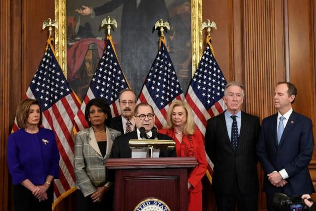 Democrats' impeachment charges say Trump betrayed the nation