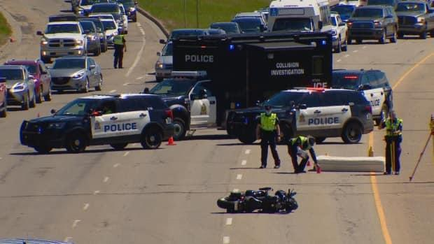 Police received reports that the rider of the motorcycle was knocked off his bike by a mattress that fell off a truck. (Scott Neufeld/CBC - image credit)