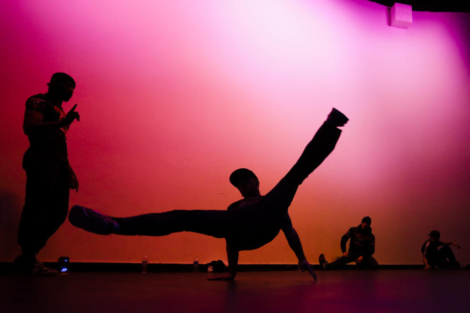 """Bboy Curca """"Bugy"""" Bogdan, center, of Romania, warms up with others before the World Bboy Battle Saturday, Dec. 21, 2019, in New York. Many in the breaking community are eager for the art form to expand its audience after the International Olympic Committee announced that it would become an official sport at the Paris 2024 games. But that optimism is hardly unanimous. (AP Photo/Frank Franklin II)"""