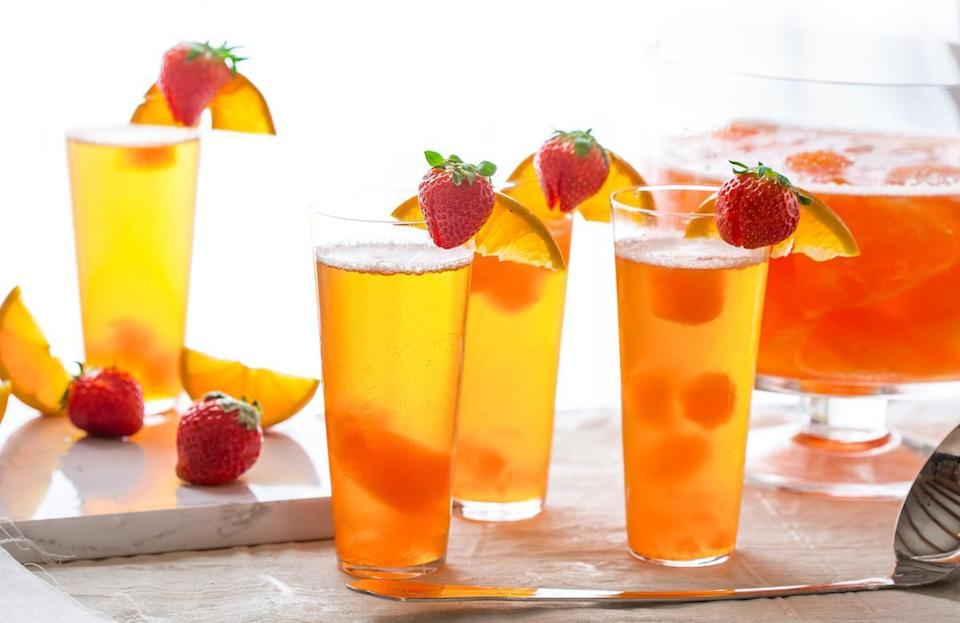 """<p>Perfect for any kind of party, this punch mixes SunnyD Orange Strawberry juice with lemon juice concentrate, flavored gelatin and tons of sugar. Add ginger ale and a mix of blueberries and strawberries <a href=""""https://www.thedailymeal.com/how-to-grocery-shop-during-coronavirus?referrer=yahoo&category=beauty_food&include_utm=1&utm_medium=referral&utm_source=yahoo&utm_campaign=feed"""" rel=""""nofollow noopener"""" target=""""_blank"""" data-ylk=""""slk:from the grocery store"""" class=""""link rapid-noclick-resp"""">from the grocery store</a>.</p> <p><a href=""""https://www.thedailymeal.com/recipes/party-punch-mocktail-sunnyd?referrer=yahoo&category=beauty_food&include_utm=1&utm_medium=referral&utm_source=yahoo&utm_campaign=feed"""" rel=""""nofollow noopener"""" target=""""_blank"""" data-ylk=""""slk:For the Party Punch recipe, click here."""" class=""""link rapid-noclick-resp"""">For the Party Punch recipe, click here.</a></p>"""