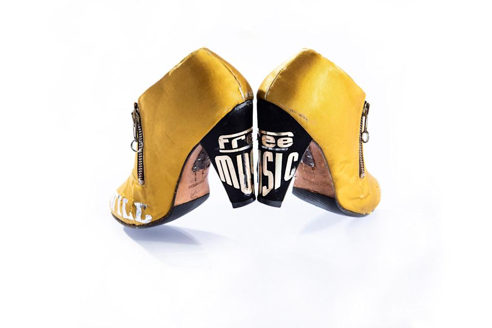 """Prince defended the idea of artist-owned music and music publishing; he disagreed with a system that allowed others to profit off something that was created by someone else. On these heels, a gold metallic sticker makes a statement about this, spelling out the words, """"Free Music."""""""