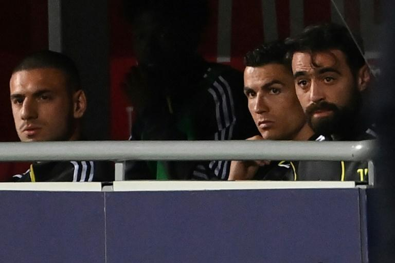 Cristiano Ronaldo (2ndR) watches from the bench in Bologna.