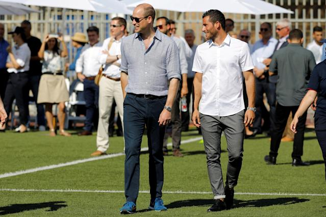 Britain's Prince William walks with Tomer Hemed, an Israeli professional footballer who plays as a striker for English Premier League club Brighton & Hove Albion during a soccer event with Jewish, Muslim and Christian children organized by The Equalizer and Peres Center for Peace in Jaffa, near Tel Aviv, Israel, June 26, 2018. REUTERS/Amir Cohen