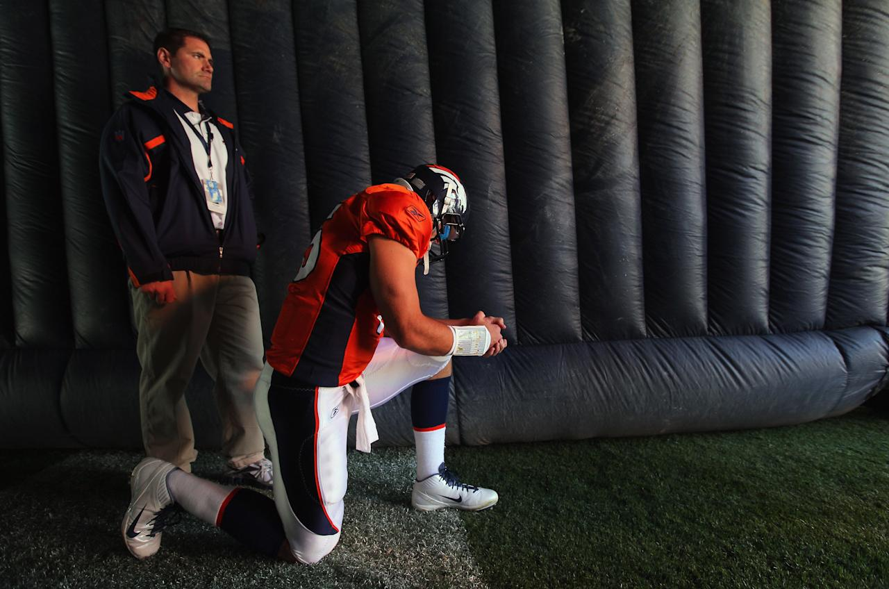 DENVER, CO - OCTOBER 30:  Quarterback Tim Tebow #15 of the Denver Broncos prepares to take the field to face the Detroit Lions Sports Authority at Invesco Field at Mile High on October 30, 2011 in Denver, Colorado.  (Photo by Doug Pensinger/Getty Images)