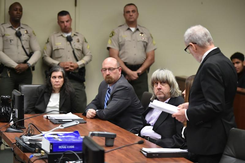 From left: Louise and David Turpin (first and third from left, seated) in court
