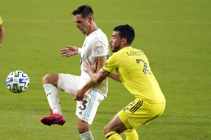 Minnesota United midfielder Ethan Finlay (13) passes the ball past Nashville defender Daniel Lovitz (2) during the second half of an MLS soccer match Tuesday, Oct. 6, 2020, in Nashville, Tenn. (AP Photo/Mark Humphrey)