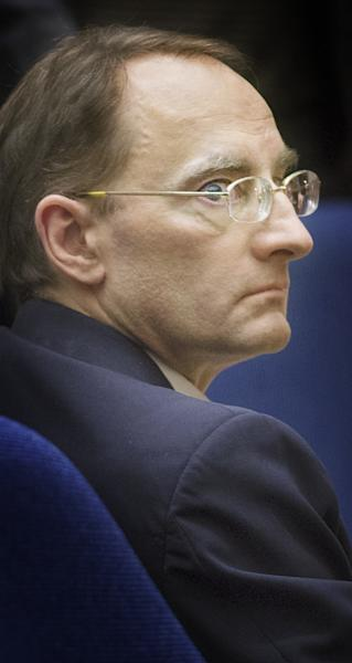Christian Gerhartsreiter listens to final arguments by prosecutor Habib Balian during his trial at Clara Shortridge Foltz Criminal Justice Center in Los Angeles Tuesday, April 9, 2013. Gerhartsreiter has pleaded not guilty to the killing of John Sohus, 27, who disappeared with his wife, Linda, in 1985 while Gerhartsreiter was a guest cottage tenant at the home of Sohus' mother, where the couple lived. (AP Photo/San Gabriel Valley Tribune,Walter Mancini, Pool )