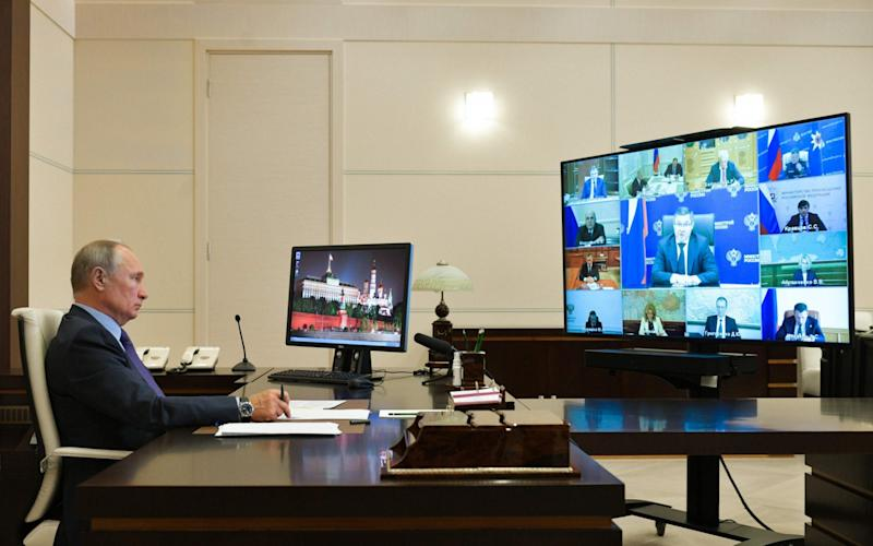 Russian President Vladimir Putin chairs a meeting with members of the government via a teleconference call at the Novo-Ogaryovo state residence - AFP