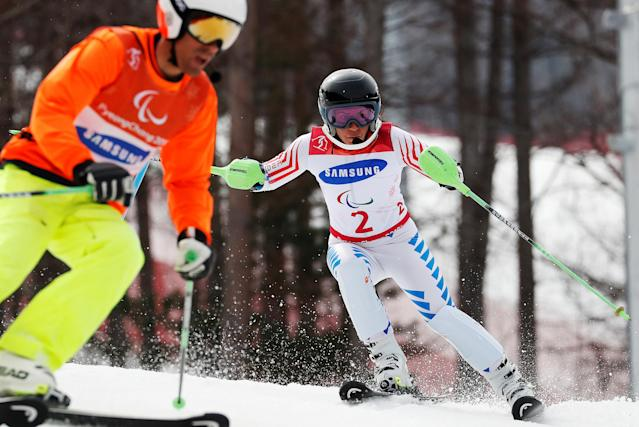Alpine Skiing - Pyeongchang 2018 Winter Paralympics - Women's Slalom - Visually Impaired - Run 2 - Jeongseon Alpine Centre - Jeongseon, South Korea - March 18, 2018 - Danelle Umstead of the U.S. and her guide. REUTERS/Paul Hanna