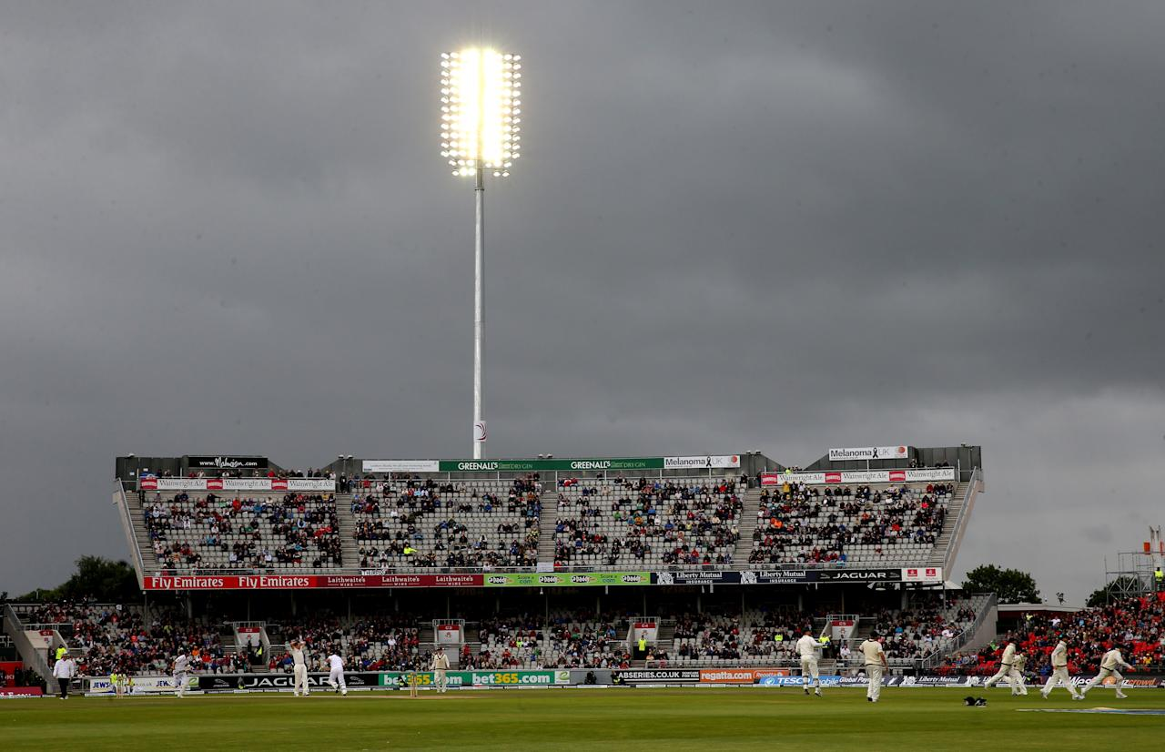 Dark clouds over Old Trafford with heavy rain as Australia bowler Peter Siddle bowls to England's Joe Root during day five of the Third Investec Ashes test match at Old Trafford Cricket Ground, Manchester.