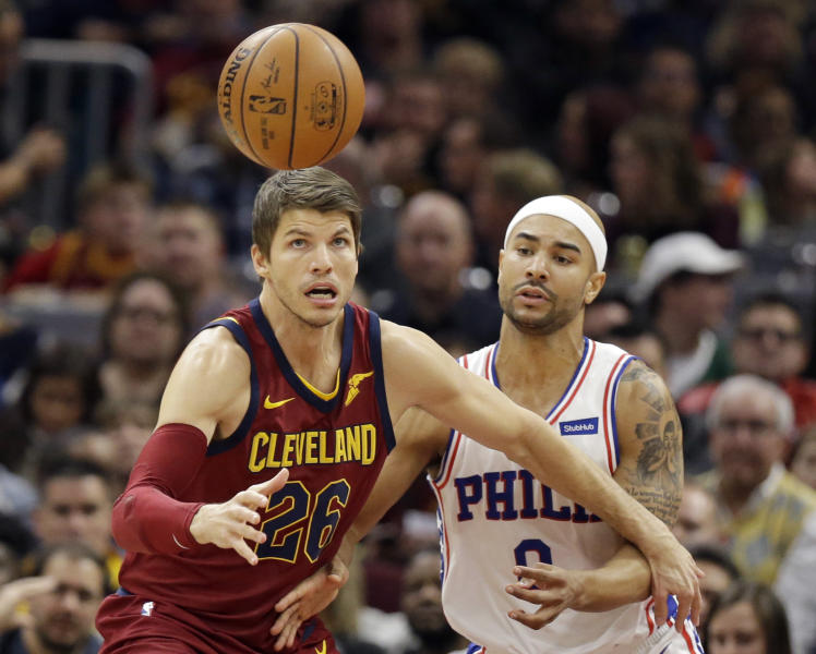 Cleveland Cavaliers' Kyle Korver (26) and Philadelphia 76ers' Jerryd Bayless (0) watch the ball during the first half of an NBA basketball game, Saturday, Dec. 9, 2017, in Cleveland. (AP Photo/Tony Dejak)