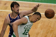 The ball gets away from Boston Celtics forward Grant Williams (12) and Phoenix Suns forward Dario Saric, left, in the first half of an NBA basketball game, Thursday, April 22, 2021, in Boston. (AP Photo/Elise Amendola)