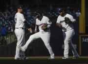 Milwaukee Brewers' Travis Shaw, Jonathan Villar and Jesus Aguilar celebrate after a baseball game against the Minnesota Twins Tuesday, July 3, 2018, in Milwaukee. The Brewers won 2-0. (AP Photo/Morry Gash)