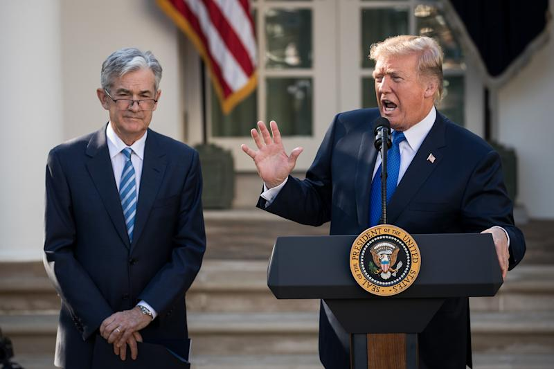 Trump takes swipe at Fed for raising interest rates too quickly