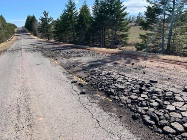 Freeze-thaw cycles over the winter months can cause pavement laid over P.E.I.'s silty soil to break up, as it did here on the Appin Road in Bonshaw.  (Nicole MacEachern - image credit)