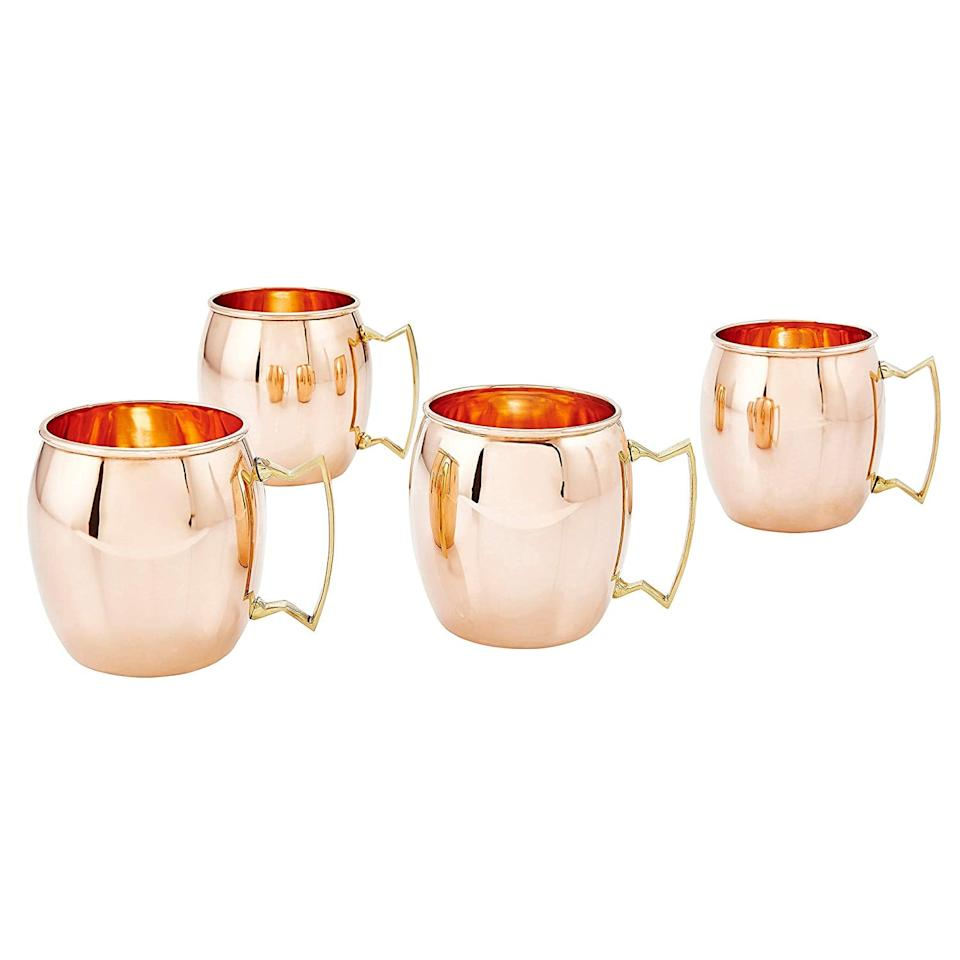 """<p>She can tuck this trusty set of <a href=""""https://www.popsugar.com/buy/16-Ounce-Old-Dutch-Moscow-Mule-Mugs-518265?p_name=16-Ounce%20Old%20Dutch%20Moscow%20Mule%20Mugs&retailer=amazon.com&pid=518265&price=41&evar1=moms%3Aus&evar9=26228388&evar98=https%3A%2F%2Fwww.popsugar.com%2Ffamily%2Fphoto-gallery%2F26228388%2Fimage%2F44318159%2F16-Ounce-Old-Dutch-Moscow-Mule-Mugs&list1=gifts%2Choliday%2Cgift%20guide%2Cgifts%20for%20women&prop13=mobile&pdata=1"""" rel=""""nofollow"""" data-shoppable-link=""""1"""" target=""""_blank"""" class=""""ga-track"""" data-ga-category=""""Related"""" data-ga-label=""""https://www.amazon.com/Old-Dutch-International-Purveyors-ORIGINAL/dp/B00HZZS9YC/"""" data-ga-action=""""In-Line Links"""">16-Ounce Old Dutch Moscow Mule Mugs</a> ($41, originally $91) away for the next party if she doesn't want to use them right away - or she can do just that and whip up a mix of Moscow mules to serve to all her friends.</p>"""