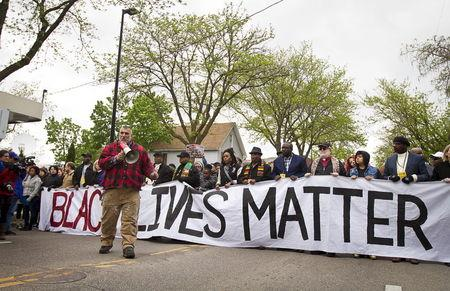 Craig Spaulding speaks to the crowd before marching after a prosecutor said that a police officer will not face charges in the fatal shooting of an unarmed 19-year-old biracial man, in Madison, Wisconsin May 12, 2015. REUTERS/Ben Brewer