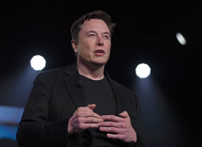FILE - In this March 14, 2019 file photo, Tesla CEO Elon Musk speaks before unveiling the Model Y at the company's design studio in Hawthorne, Calif. Musk will face the electric car maker's shareholders during the company's annual meeting on Tuesday, June 11. (AP Photo/Jae C. Hong, File)